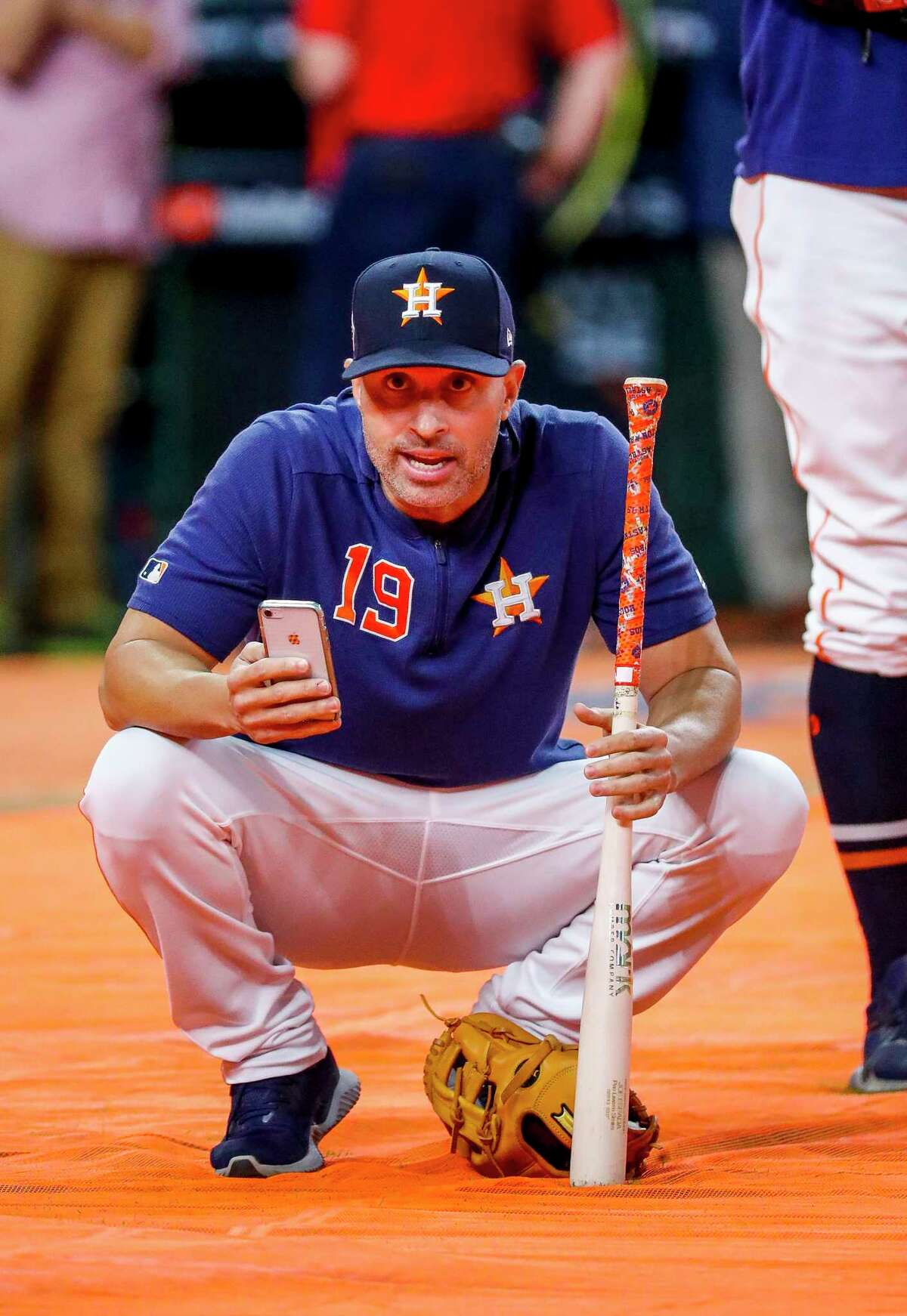 Houston Astros bench coach Joe Espada (19) watches during batting practice before Game 6 of the World Series at Minute Maid Park on Tuesday, Oct. 29, 2019, in Houston.