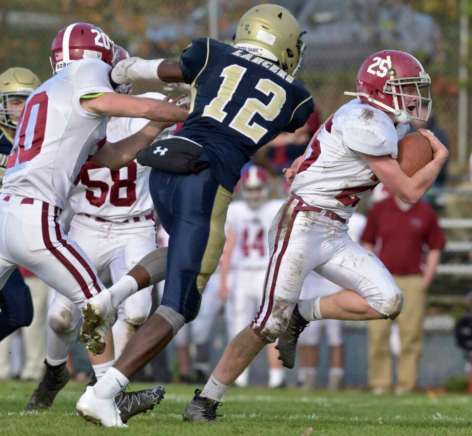 Bethel's Morgan Haskett (25) scored two two touchdowns in a 28-18 win over Law on Friday. The victory snapped a 13-game losing streak for the Wildcats. Photo: H John Voorhees III / Hearst Connecticut Media / The News-Times