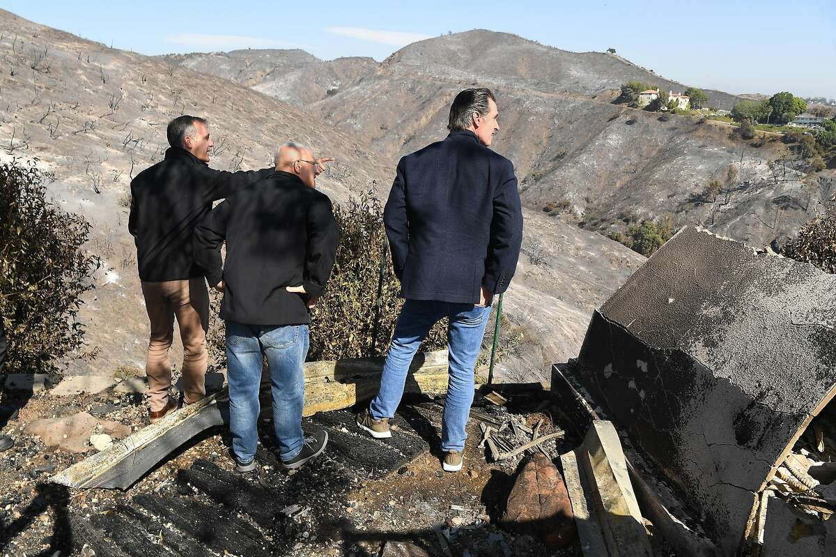 From left, L.A. Mayor Eric Garcetti, L.A. City Councilman Mike Bonin and California Governor Gavin Newsom view a burned home along Tigertail Road Tuesday, Oct. 29, 2019 in Bretwood, Calif. (Wally Skalij/Los Angerles Times/TNS)
