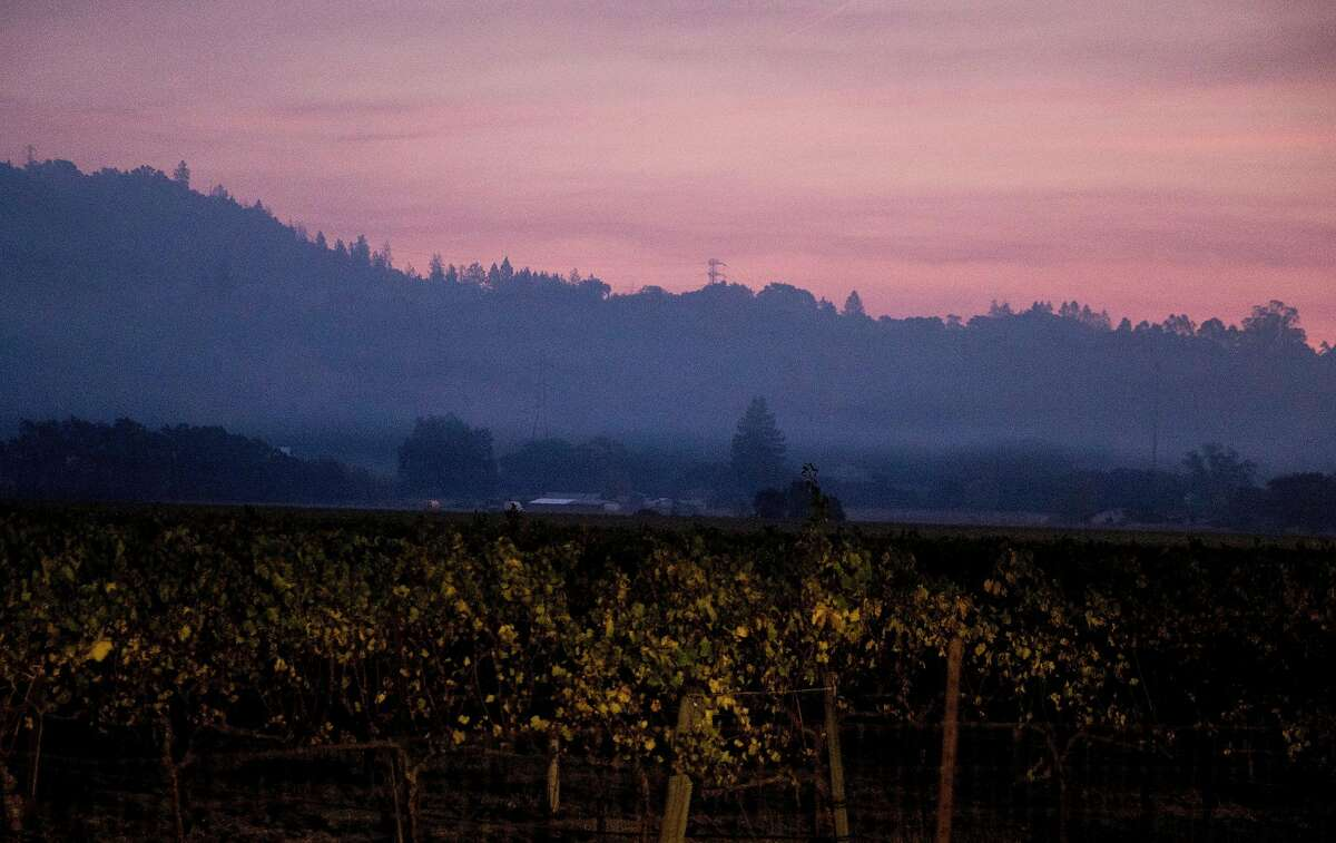 The sun rises through smoky skies over the hills of Shiloh Ranch Regional Park in Santa Rosa, Calif. Tuesday, Oct. 29, 2019.