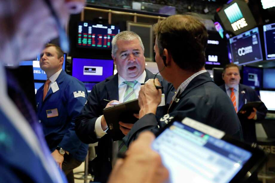 Edward McCarthy, center, works with fellow traders on the floor of the New York Stock Exchange, Tuesday, Oct. 29, 2019. Photo: Richard Drew / Copyright 2019 The Associated Press. All rights reserved