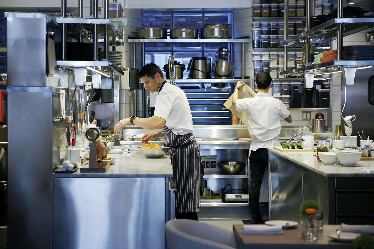 Chef Nicolas Delaroque prepares food for the evening open at Nico, Friday, June 22, 2018, in San Francisco, Calif. The restaurant is located at 710 Montgomery Street.