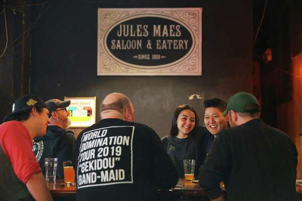 Patrons drink in the game room at Georgetown's Jules Maes Saloon & Eatery which first opened in 1888. Photographed Oct. 25, 2019.