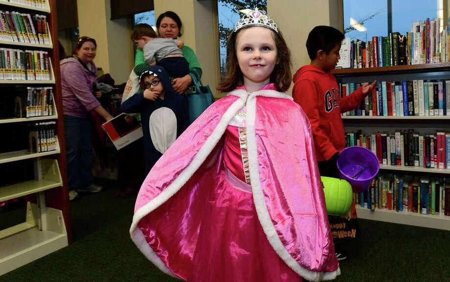 Darien Beyers, 6 of Wilton, participates in the annual library parade during The SoNo Branch Library Spooktacular Tuesday, October 29, 2019, in Norwalk, Conn. Children of all ages were invited to come dressed in their costume, watch Bob Conrad perform music and magic and trick or treat inside the library. Photo: Erik Trautmann / Hearst Connecticut Media / Norwalk Hour