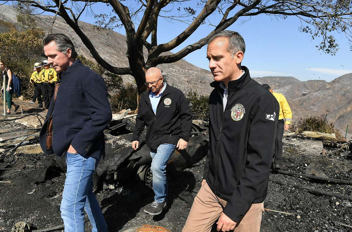 From left, California Governor Gavin Newsom, L.A. City Councilman Mike Bonin, and L.A. City Mayor Eric Garcetti tour a burned home along Tigertail Road Tuesday, Oct. 29, 2019 in Bretwood, Calif. (Wally Skalij/Los Angerles Times/TNS)