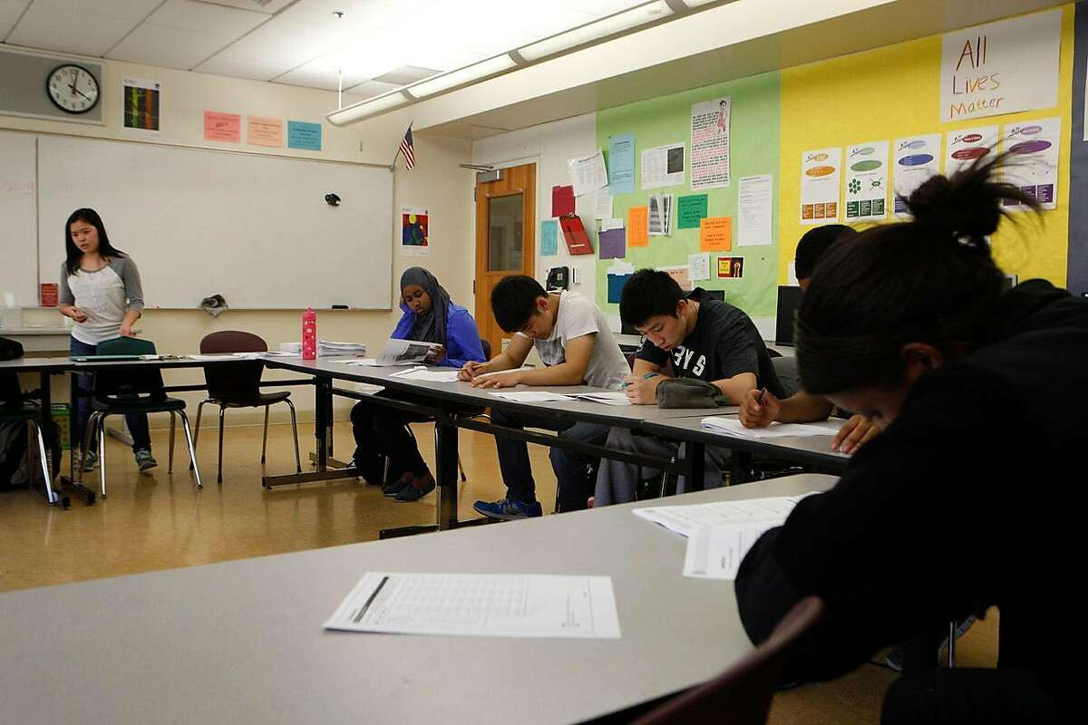 Students take the new practice test during an SAT Prep class held at Berkeley High School in Berkeley, Calif., Thursday, Feb. 11, 2016.On Tuesday, a superior court judge barred the University of California from using the SAT and ACT tests for admissions.