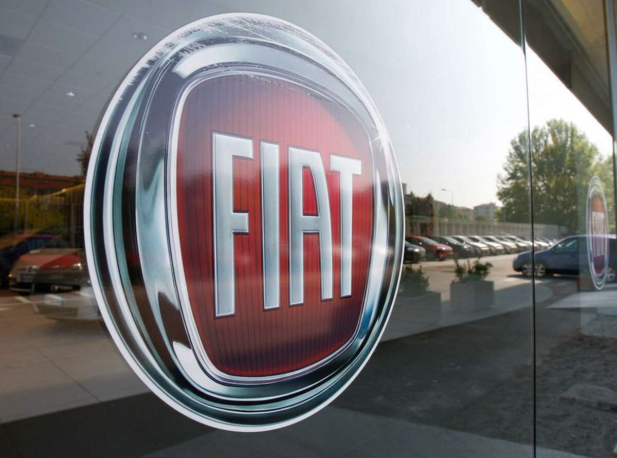 In this May 7, 2009 file photo, a Fiat logo is seen on a car retailer's window in Milan, Italy. A federal bankruptcy judge approved the sale of most of Chrysler's assets late Sunday, May 31, 2009, to Italy's Fiat, moving the American automakera step closer to its goal of a quick exit from court protection.