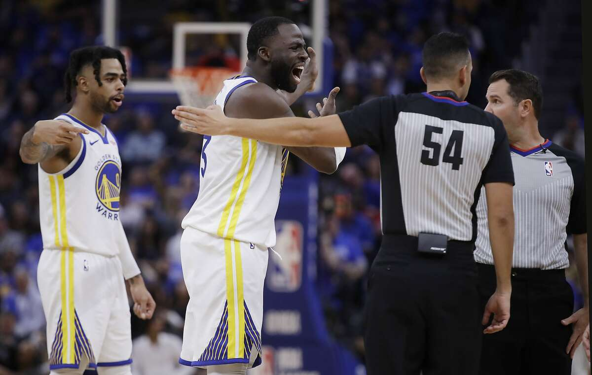 Golden State Warriors' Draymond Green, second from left, argues with referees during the second half of the team's NBA basketball game against the Los Angeles Clippers on Thursday, Oct. 24, 2019, in San Francisco. (AP Photo/Ben Margot)