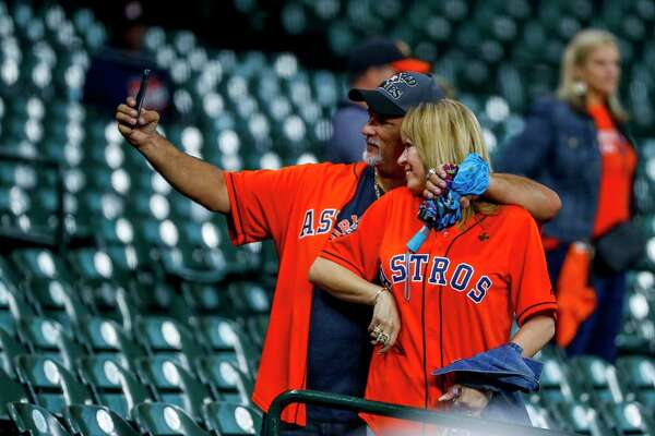 Astros fans find their seats during batting practice before Game 6 of the World Series at Minute Maid Park on Tuesday, Oct. 29, 2019, in Houston.