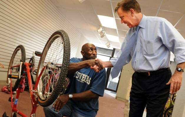 Democratic gubernatorial candidate Ned Lamont meets volunteer Gary Anderson, of Bridgeport, Wednesday July 28, 2010 during a tour of Fresh Start Enterprises in Bridgeport.  Fresh Start works in collaboration with the CT Bike Project and Catholic Charities collecting, repairing and distributing donated bicycles to city residents. Photo: Autumn Driscoll / Connecticut Post