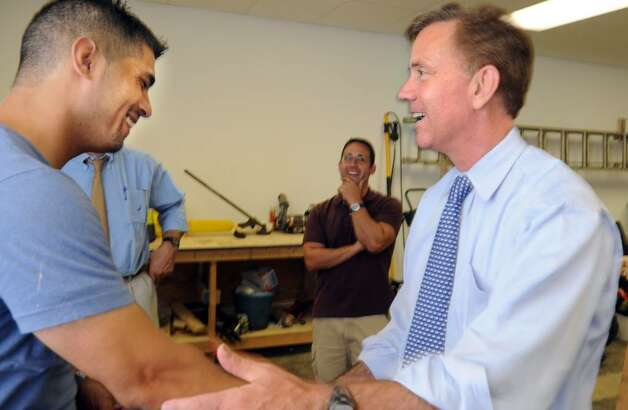 "Democratic gubernatorial candidate Ned Lamont shakes hands with graduate volunteer Jose Nieves, now a crew chief with Fresh Start Enterprises in Bridgeport, Wednesday July 28, 2010 during a tour of their downtown Bridgeport offices.  The Fresh Start Program helps soon-to-be released prisoners before leaving prison, during transition and after ""coming home"".  The program places emphasis on post-employment, strengthening families and giving back to the community. Photo: Autumn Driscoll / Connecticut Post"