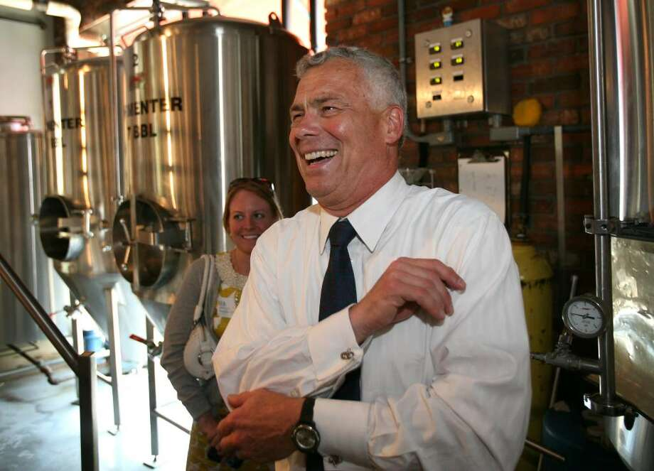 Republican gubenatorial candidate Oz Griebel has a laugh during his visit to the Southport Brewing Company in Fairfield recently. Photo: Brian A. Pounds / Connecticut Post