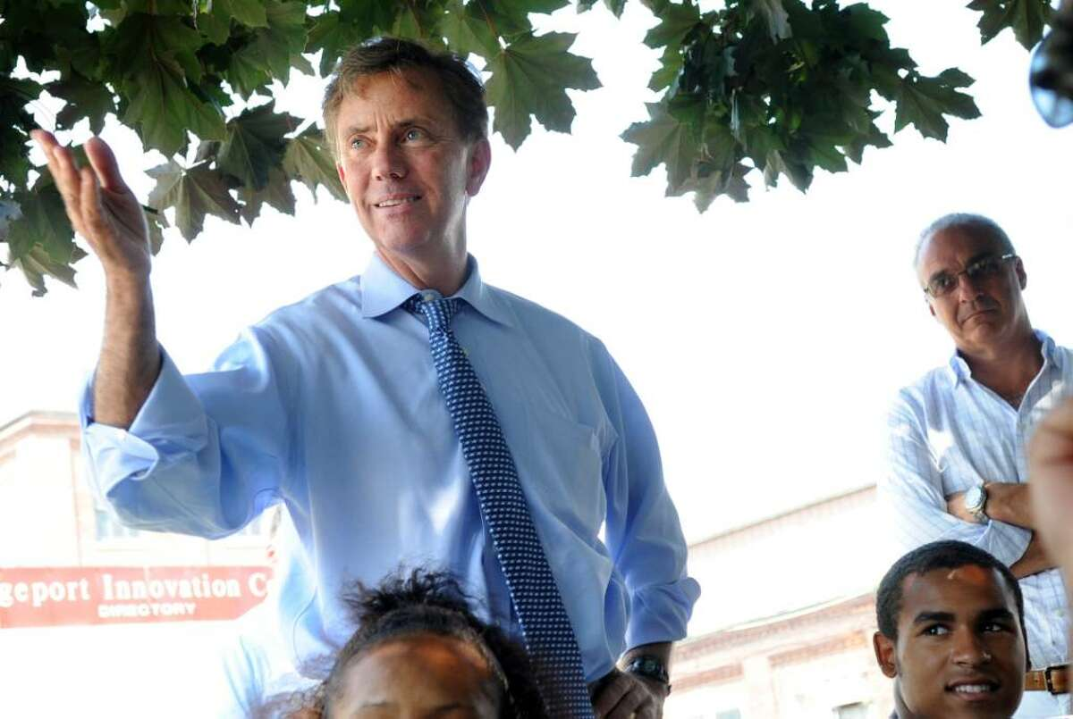 Democratic gubernatorial candidate Ned Lamont talks with a group of young people from YouthWorks; a program for low-income youth, ages 14 to 21 offering workforce development services, Wednesday July 28, 2010 during a visit to Bridgeport.