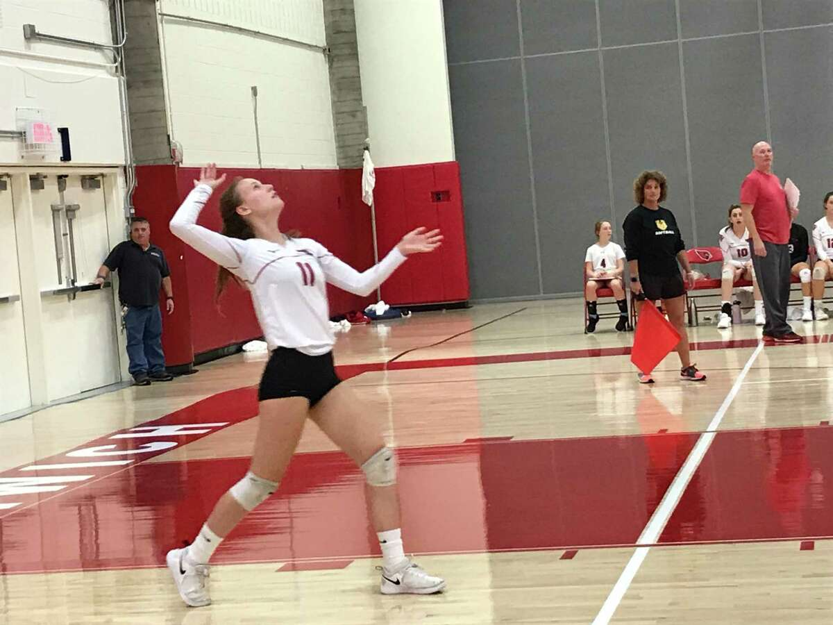 Celeste Walstrom-Vangor serves for the Greenwich girls volleyball team during its 3-0 win vs. Trinity Catholic on Tuesday, October 29, 2019.