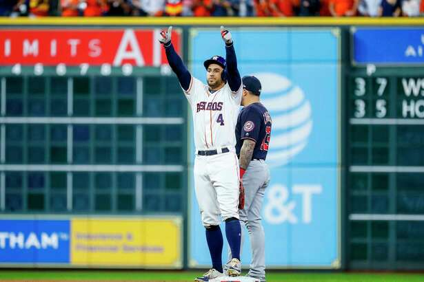 Houston Astros center fielder George Springer (4) celebrates a leadoff double to start the first inning of Game 6 of the World Series at Minute Maid Park on Tuesday, Oct. 29, 2019, in Houston.