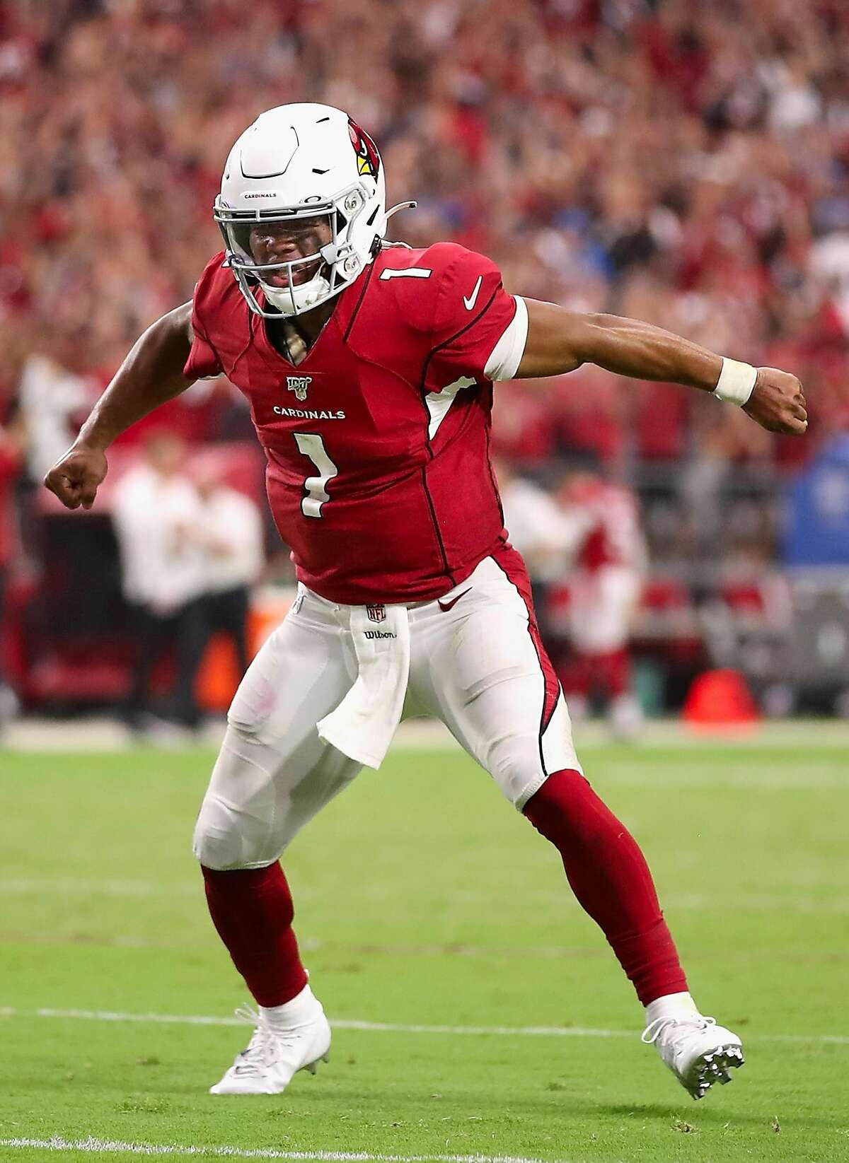 GLENDALE, ARIZONA - SEPTEMBER 08: Quarterback Kyler Murray #1 of the Arizona Cardinals celebrates after converting a two-point conversion against the Detroit Lions during the final moments of the second half of the NFL game at State Farm Stadium on Septe