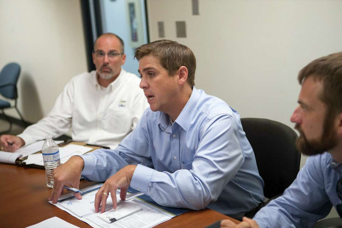 Guadalupe-Blanco River Authority officials speak with the San Antonio Express-News editorial board in August about the dams at its lakes.