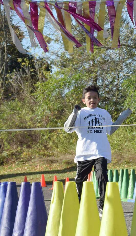 Fifth grader Anthony Diaz approaches the finish line to take the first-place medal. Photo: Deborah Rose / Hearst Connecticut Media / The News-Times  / Spectrum