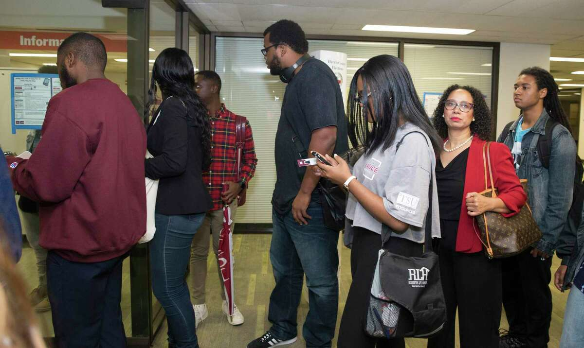 A group of students wait in the line to vote at the Texas Southern University early voting location after a rally with mayor Sylvester Turner on Monday, Oct. 21, 2019, in Houston. Early voting began Monday ahead of the November 5 election, when Houston and Harris County voters will cast ballots for mayor, city council, controller and a host of referendums and other offices.