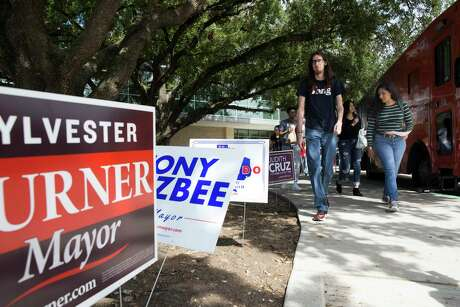 Election signs are placed outside the University of Houston early voting location. Run-off elections are set for Dec. 14.