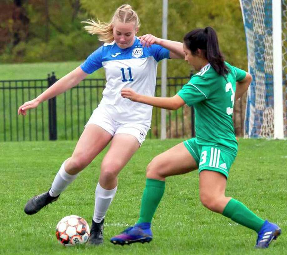 Candice Parziani of LCCC (11) controls the ball against Gissel Garcia of John Wood College in an NJCAA Region 24 Tournament quarterfinal Tuesday at LCCC's Tim Rooney Stadium. Photo: Jan Dona | For The Telegraph