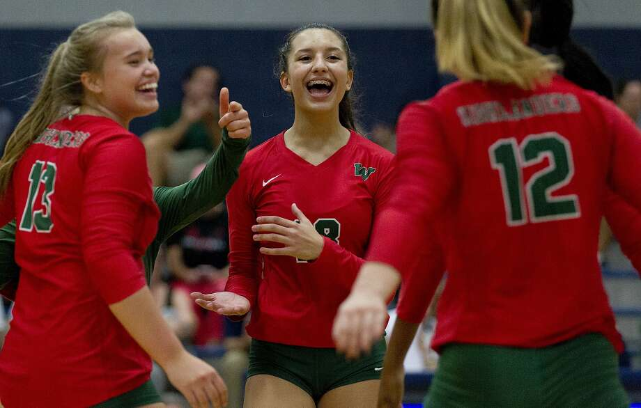 The Woodlands outside hitter Julieta Valdes (18) reacts toward setter Clara Brower (12) after a point in the first set of a non-district high school volleyball match at Concordia Lutheran High School, Tuesday, Aug. 27, 2019, in Tomball. Photo: Jason Fochtman, Staff Photographer