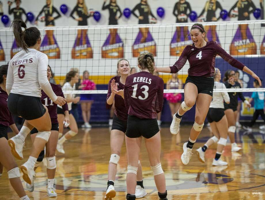 Lee celebrates a point against Midland High on Tuesday, Oct. 29, 2019 at Midland High School. Photo: Jacy Lewis/Reporter-Telegram