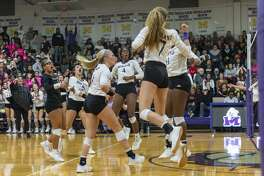 Midland High celebrates a point against Lee on Tuesday, Oct. 29, 2019 at Midland High School.