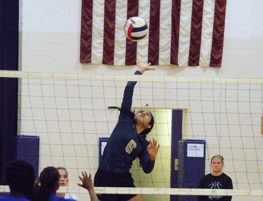 Father McGivney's Haydee Rios goes up for a kill during the first game of Tuesday's quarterfinal match against Lovejoy at the Class 1A Valmeyer Regional. Photo: Scott Marion/The Intelligencer