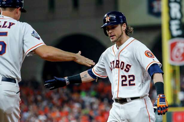 Houston Astros right fielder Josh Reddick (22) celebrates his single during the fifth inning of Game 6 of the World Series at Minute Maid Park on Tuesday, Oct. 29, 2019, in Houston.
