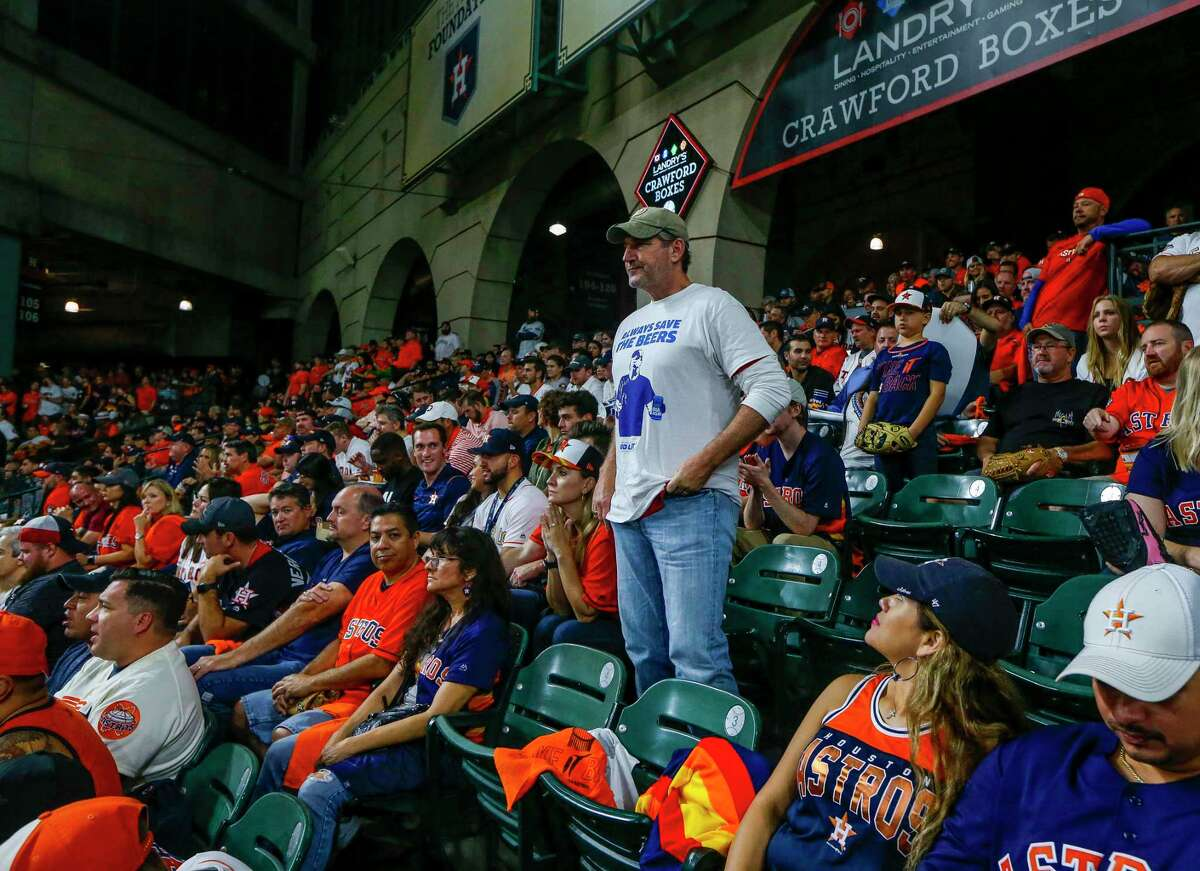 Jeff Adams, who was hit by a home run ball while holding two beers during Game 5 of the World Series in Washington, D.C., watches Game 6 of the World Series at Minute Maid Park on Tuesday, Oct. 29, 2019, in Houston.