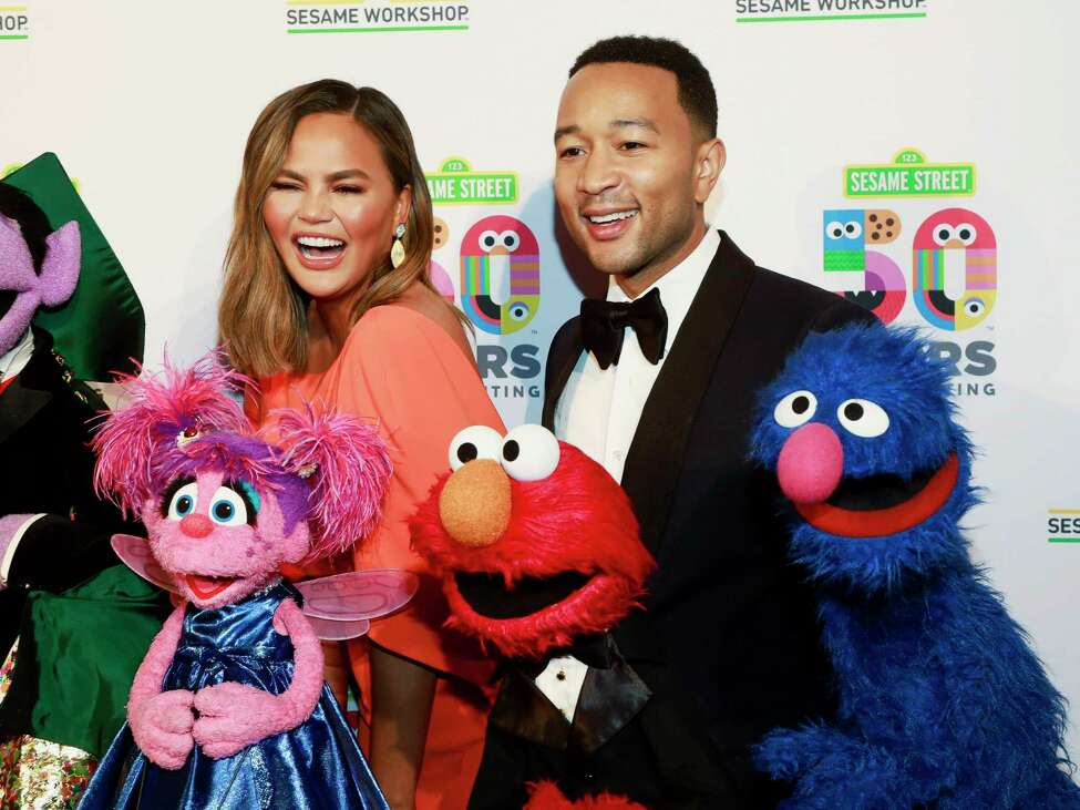 Chrissy Teigen, left, and John Legend, right, attend the Sesame Workshop's 50th anniversary benefit gala at Cipriani Wall Street on Wednesday, May 29, 2019, in New York. (Photo by Andy Kropa/Invision/AP)