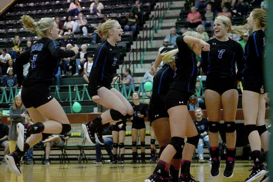 Hardin's varsity react as they score against East Chambers  during their volleyball match-up Tuesday in Winnie. Photo taken Tuesday, October 29, 2019 Kim Brent/The Enterprise Photo: Kim Brent / The Enterprise / BEN