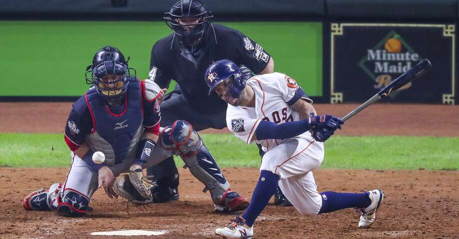 Houston Astros second baseman Jose Altuve (27) strikes out to end the fifth inning and strand two base runners during Game 6 of the World Series at Minute Maid Park on Tuesday, Oct. 29, 2019, in Houston. Photo: Godofredo A Vásquez/Staff Photographer