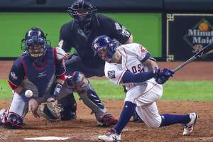 Houston Astros second baseman Jose Altuve (27) strikes out to end the fifth inning and strand two base runners during Game 6 of the World Series at Minute Maid Park on Tuesday, Oct. 29, 2019, in Houston.