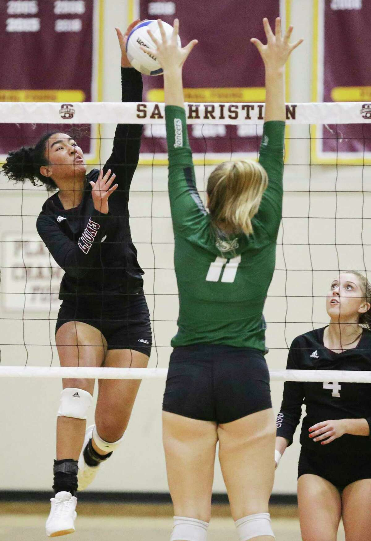 Adriana Ellard smashes a shot through the defense for the Lions as San Antonio Christian plays Houston Lutheran South in the second round TAPPS 5A volleyball playoffs at San Antonio Christian gym on 29, 2019.