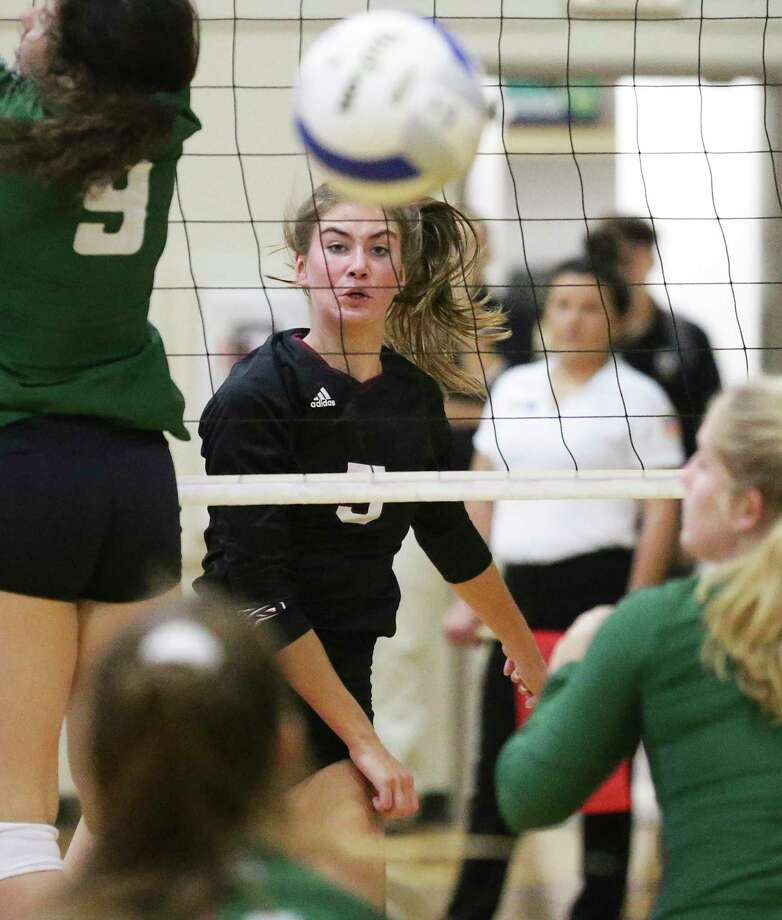 Sadie Nelson follows her kill shot down to the floor for the Lions as San Antonio Christian plays Houston Lutheran South in the second round TAPPS 5A volleyball playoffs at San Antonio Christian gym on 29, 2019. Photo: Tom Reel, Staff / Staff Photographer / 2019 SAN ANTONIO EXPRESS-NEWS
