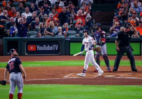 Astros third baseman Alex Bregman admires the flight of his solo home run that gave the Astros a 2-1 lead in the first inning of Game 6 of the World Series on Tuesday night.