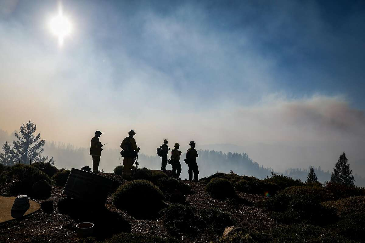 Firefighters monitor the Kincade Fire which was burning near Ida Clayton Road in Calistoga, California, on Tuesday, Oct. 29, 2019.