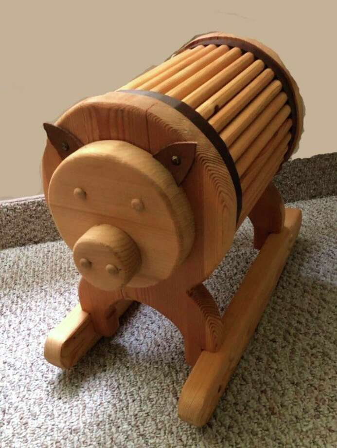 The crafters also will be auctioning off a large wooden piggy bank, with proceeds given to the family. (Photo photo/Cathy Chaffee)