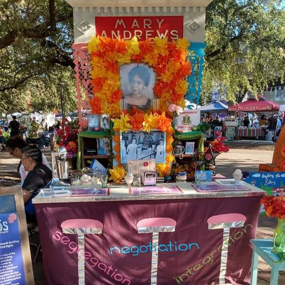 The Coalition for the Woolworth Building set up an altar at the 7th Annual Día de los Muertos Fest at Hemisfair in honor of the Woolworth Building's integrated lunch counter. The altar had a photograph of Mary Andrews, who was a freshman at Our Lady of the Lake University and president of the NAACP's local youth group when she wrote to San Antonio's downtown store managers in 1960 asking that they end segregation at their lunch counters.
