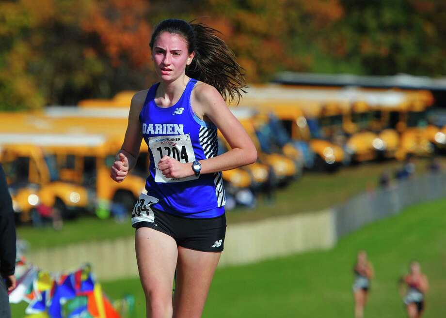 Darien's Mairead Clas approaches the finish line for fourth place during Class L cross country championship action in Manchester on Saturday. Photo: Christian Abraham / Hearst Connecticut Media / Connecticut Post