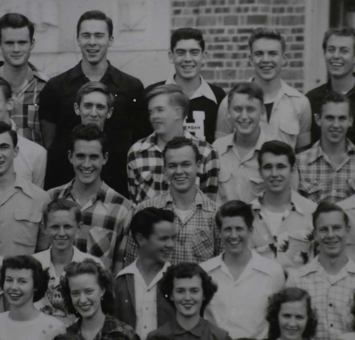 A 1950 Heights High School photo, formerly called Reagan, features broadcast journalist Dan Rather ( center, top row ) Tuesday, Oct. 29, 2019, in Houston.