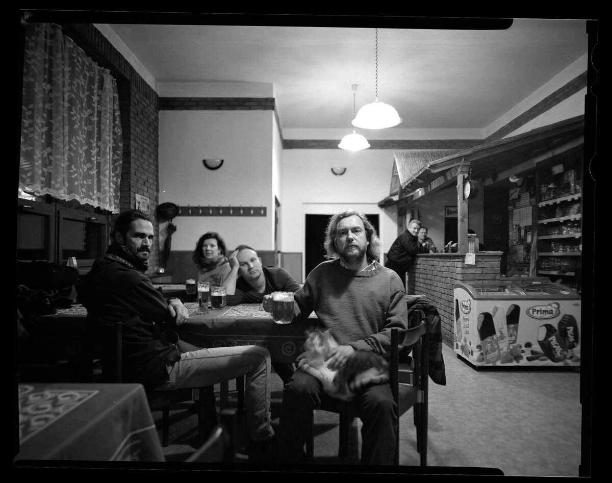 """Gabriela Kolcavová's """"Celechovice Pub,"""" shot this year, depicts the artists of """"Velvet Generation,"""" including (l-r) Vojtech V. Sláma, Kolcavová, Roman Franc and Igor Malijevský."""
