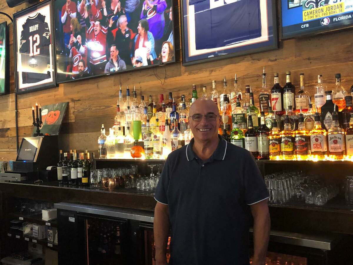 Mike Recchia at the bar of his new restaurant, Stormy's Bull & Barley.