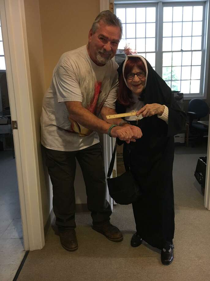 Virginia Diaz, as the nun, won best costume at the Shelton Senior Center's Halloween party on Oct. 25. Here, Diaz smacks custodian Art Botsford's hand with a ruler. Photo: Contributed Photo / / Connecticut Post