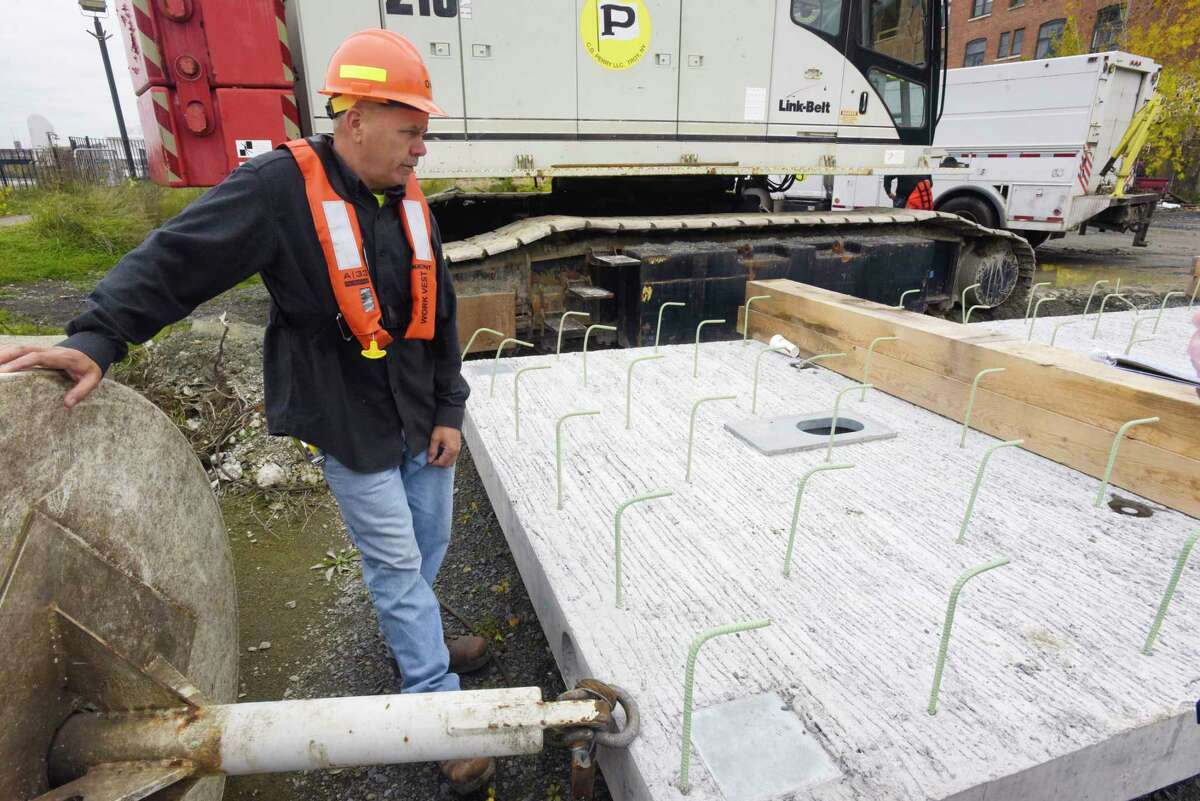 Jan Peterson, a City of Troy consultant/resident engineer for the project, stands near one of the pre-cast concrete panels that are being used to repair certain sections of the seawall on Wednesday, Oct. 30, 2019, in Troy, N.Y. (Paul Buckowski/Times Union)