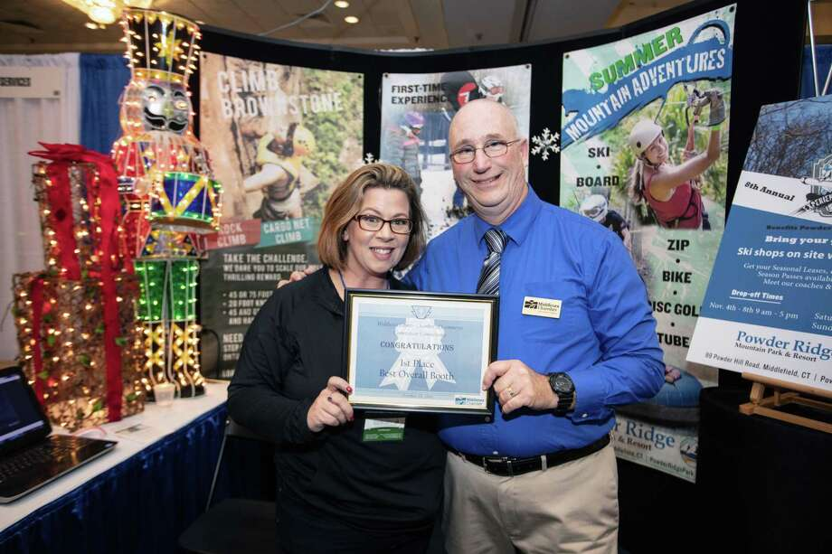 Powder Ridge Mountain Park & Resort in Middlefield won the 2019 Connecticut Connections Best Booth Award. From left are Powder Ridge sales executive Liz Wosczyna and Connecticut Connections' Lou Brockett.  Photo: De Kine Photo LLC