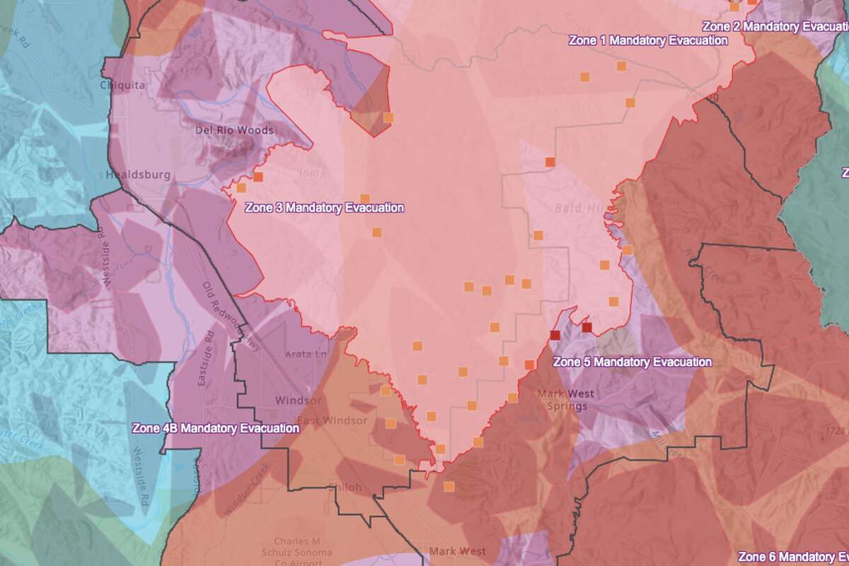 Sonoma County Incident map shows the Kincade Fire perimeter on the morning of Oct. 30, 2019. Red dots indicate where fires have been detected. Purple is the mandatory evacuation zone, blue is an evacuation advisory zone. Yellow is a PG&E power shut-off area.