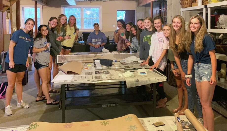 "Members of The National Charity League (NCL) of Ridgefield recently made hand-stamped craft paper, gift tags and bows for Housatonic Habitat for Humanity's ""Wrapping for Habitat"" fundraising event. Photo: Contributed Photo."